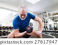 Senior man in gym working out with weights. 27617947