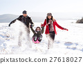 Father and mother with their daughter, playing in 27618027