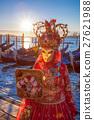 Carnival mask against dondolas in Venice, Italy 27621988