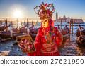 Carnival mask against dondolas in Venice, Italy 27621990