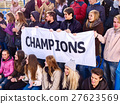 Cheering fans in stadium holding champion banner. 27623569