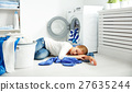 tired unhappy woman housewife is engaged in the laundry, 27635244
