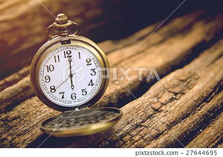 vintage pocket watch on grunge wooden board 27644695