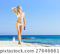 Woman posing in a white swimsuit on the beach 27646661