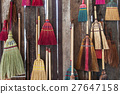 Colorful broom on the wodden wall 27647158