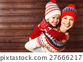 happy family mother and child girl  hugs at wooden background. 27666217