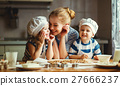 happy family in kitchen. mother and children preparing dough, ba 27666237