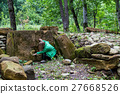 Tourist explores dolmen in the forest 27668526