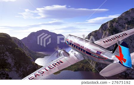 DC3 flying over mountains and lake, with sky. 27675192
