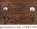 White chamomile flower on wooden background. 27682346