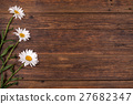 White daisy flowers on wooden background. 27682347