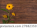 yellow flower on wooden table background. 27682350