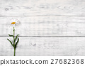 White daisy flower on old wooden table. top view 27682368