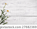 White daisy flowers on  wooden table background. 27682369