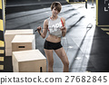 Sportive girl does exercise in gym 27682845
