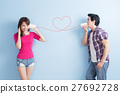young couple with can phone 27692728