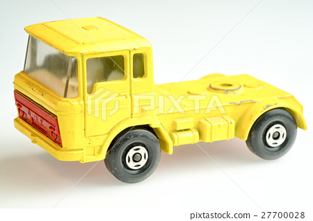 Yellow toy DAF lorry on a white background. 27700028