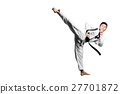 Portrait of a handsome asian man kick  27701872