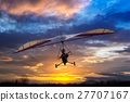 Motorized hang glider flying in the sunset 27707167