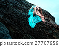 Woman posing on a beach with rocks 27707959