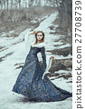 The woman in blue coat 27708739