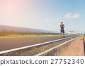 handsome man running on road with solar power plant in morning ; 27752340