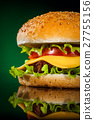 Tasty and appetizing hamburger on a darkly green 27755156