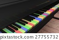 Piano with differntly colored keys on wooden floor 27755732