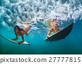 Active girl in bikini in dive action on surf board 27777815