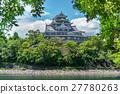 Okayama castle behind trees, Japan 27780263