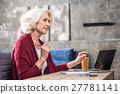 Senior woman holding pen 27781141