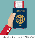 passport with boarding pass in hand 27782552