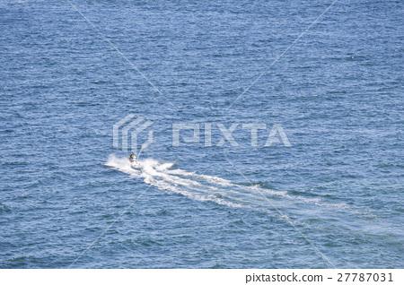 people ride jetski on blue sea 27787031