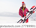 Sport woman  snowboarder on snow over blue sky 27789901