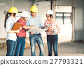 Diverse group of engineers at construction site 27793321