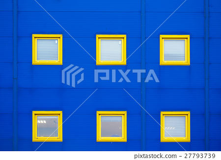 Facade of a modern blue warehouse and six yellow 27793739