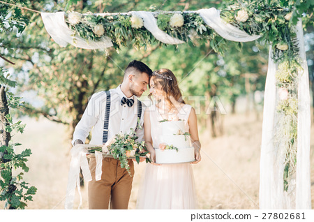 bride and groom hugging at the wedding in nature. 27802681