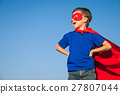 Happy little child playing superhero. 27807044