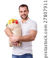 Man with paper bag full of vegetables 27807911