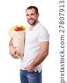 Man holding paper bag full of vegetables 27807913
