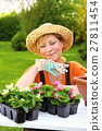 Young woman planting flower seedlings, gardening 27811454