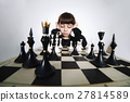 little girl playing chess on white 27814589