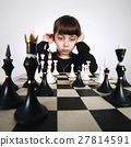 little girl playing chess on white 27814591