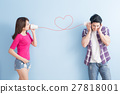 young couple with can phone 27818001