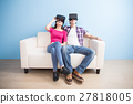 young couple watch vr game 27818005