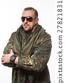 adult scary man in a camouflage jacket. a 27821831