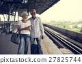 Senior couple traveling train station 27825744