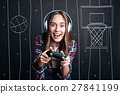 Overjoyed delighted woman plauing video games 27841199
