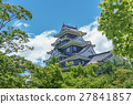 Okayama castle behind trees, Japan. Side view 27841857