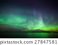 Northern lights over lake in finland 27847581